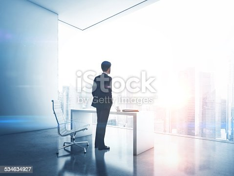 Man wearing suit is in contemporary office
