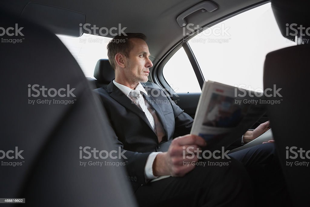 A businessman looking out the window stock photo