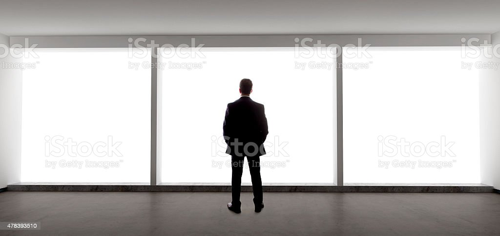 Businessman Looking Out The Window stock photo