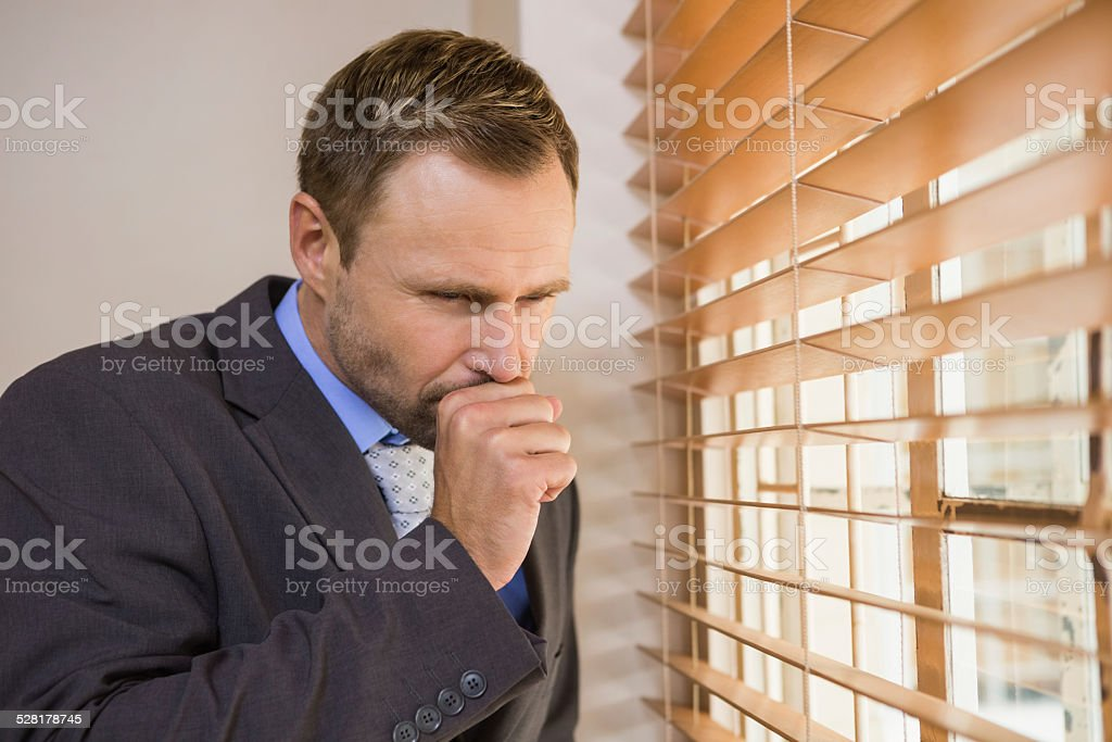 Businessman looking out the window royalty-free stock photo
