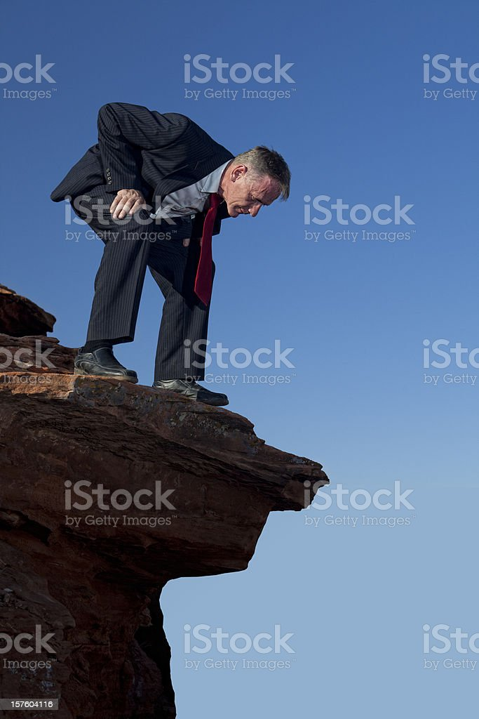 Businessman Looking Over The Edge royalty-free stock photo