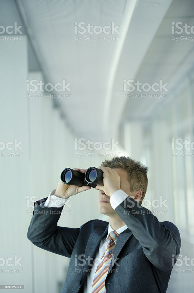 Businessman Looking Through Binoculars royalty-free stock photo