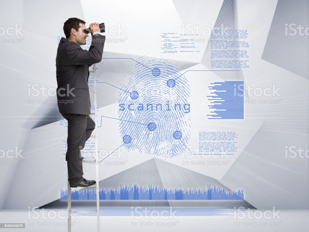 Businessman looking through binoculars to blue holographic finger print stock photo
