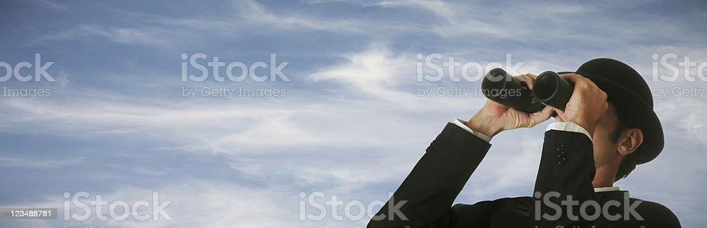 Businessman looking through binoculars XXL royalty-free stock photo