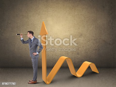 Businessman looking through telescope by successful business graph