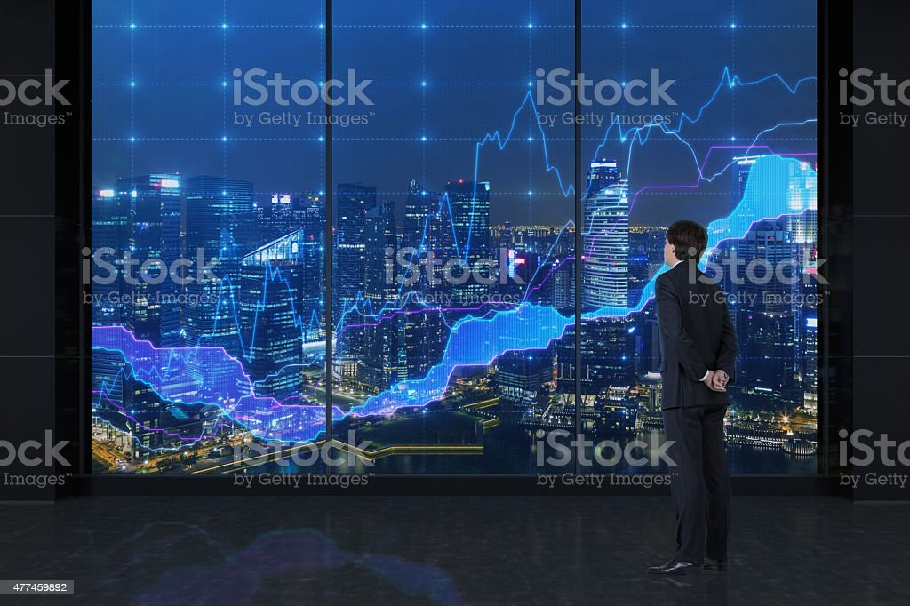 businessman looking to charts businessman looking to charts and view on city 2015 Stock Photo