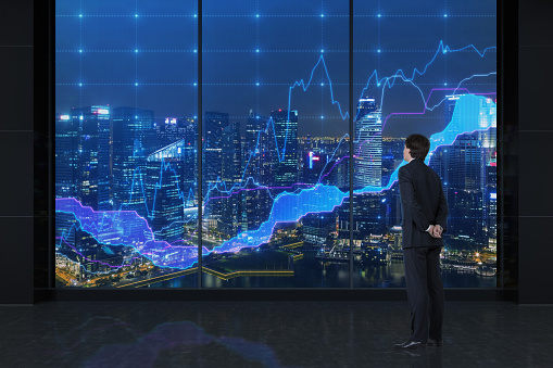 Businessman Looking To Charts Stock Photo - Download Image Now