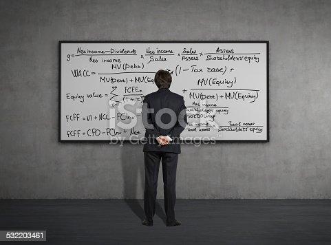 istock Businessman looking to formulas 532203461
