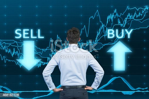 istock businessman looking to graph 468162128