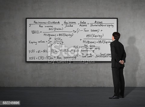 187883159istockphoto businessman looking to mathematic formulas 532245695