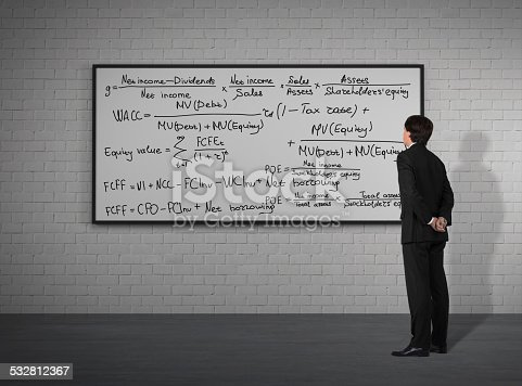 187883159istockphoto businessman looking to mathematic formulas 532812367