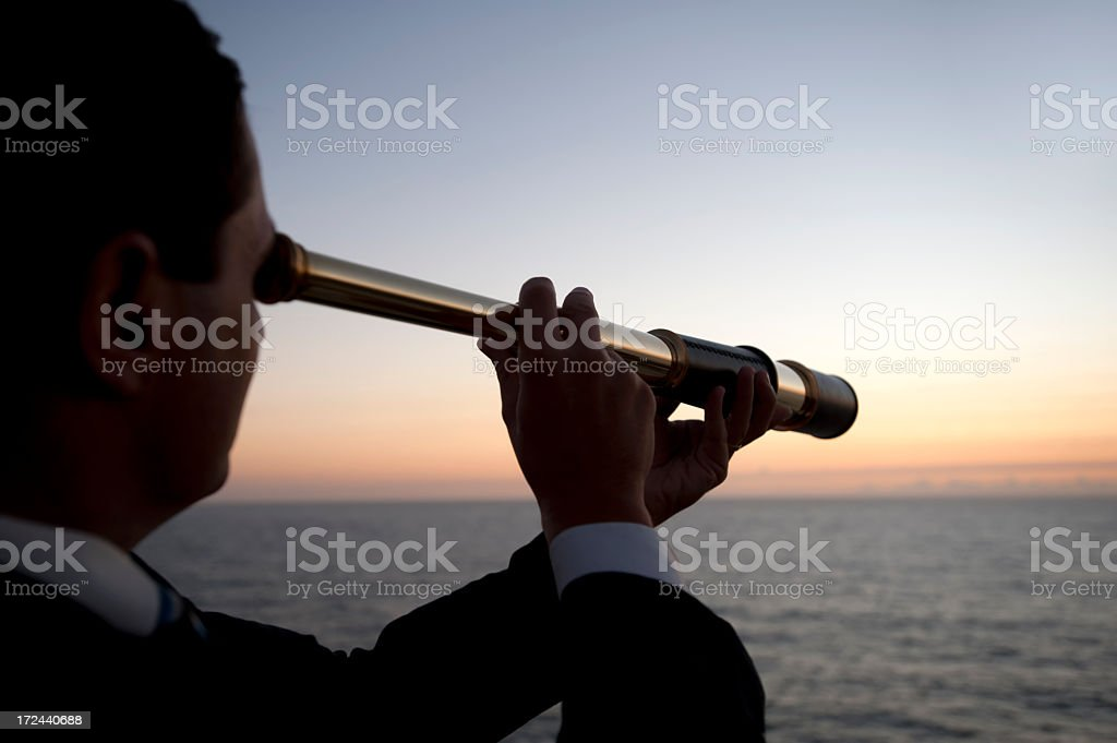 Businessman looking to the future with telescope stock photo