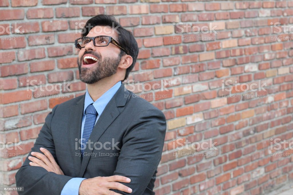 Businessman looking up and smiling stock photo
