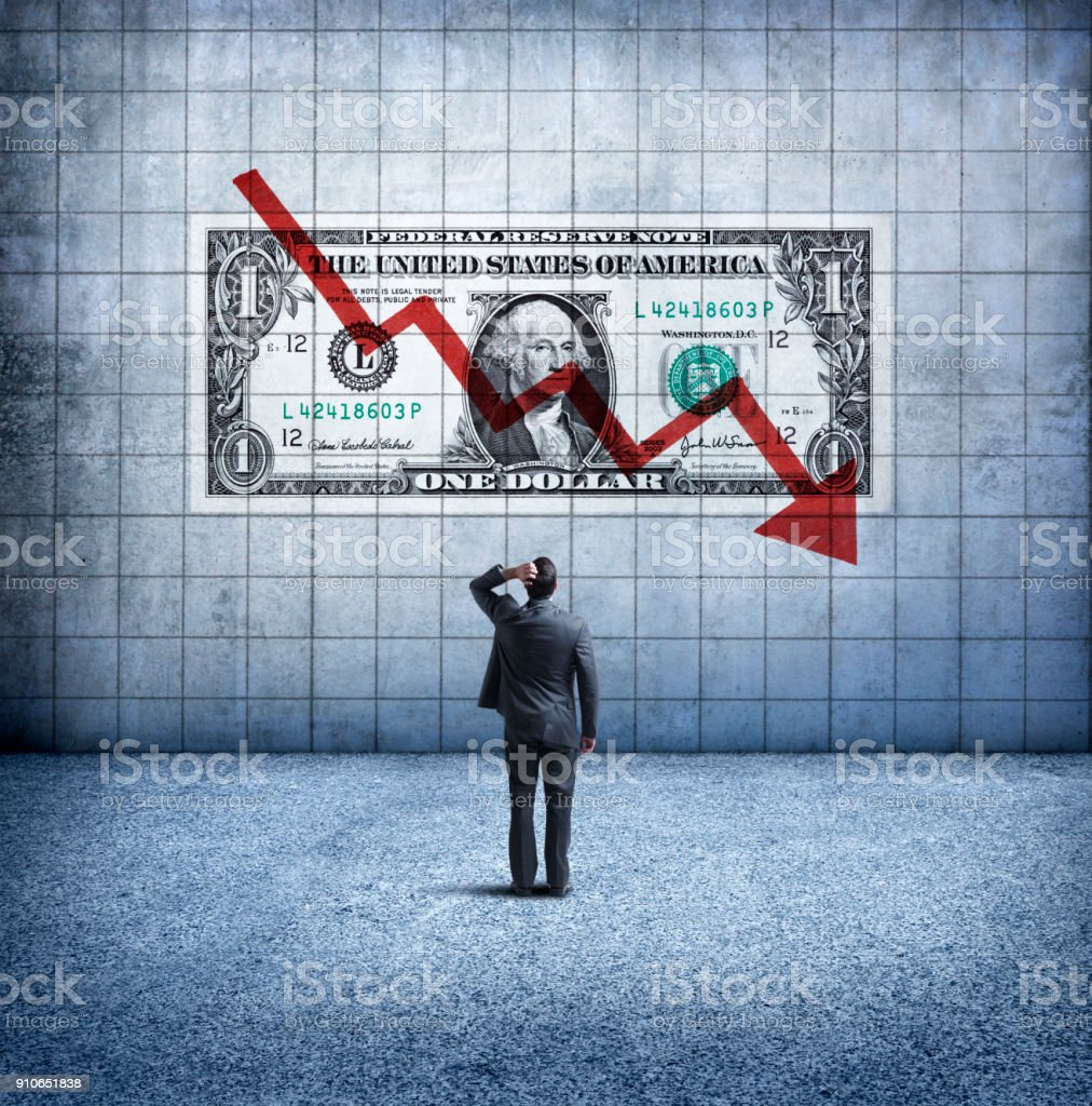 Businessman Looking Up At a Chart That Indicates A Falling U.S. Dollar stock photo