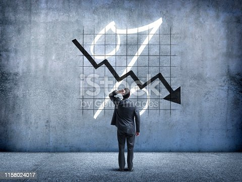 istock Businessman Looking Up At Falling Interest Rates 1158024017
