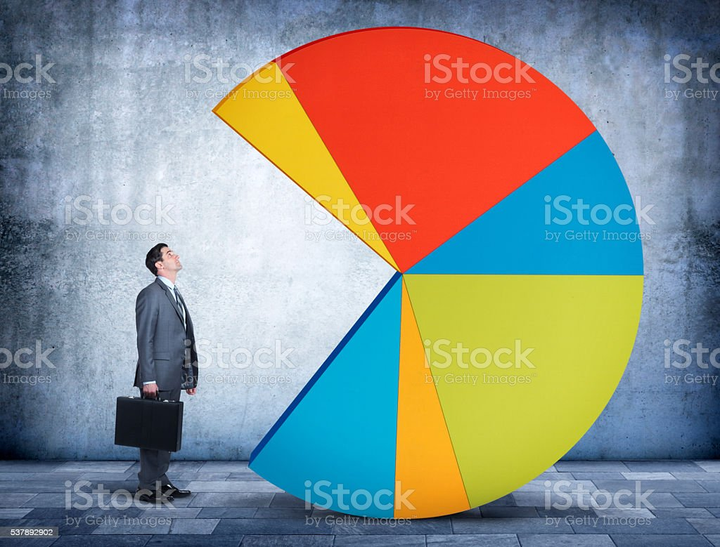 Businessman Looking Up At Pie Chart With Missing Piece stock photo