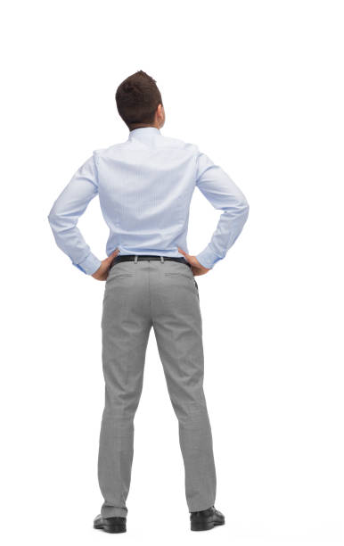 businessman looking up from back stock photo