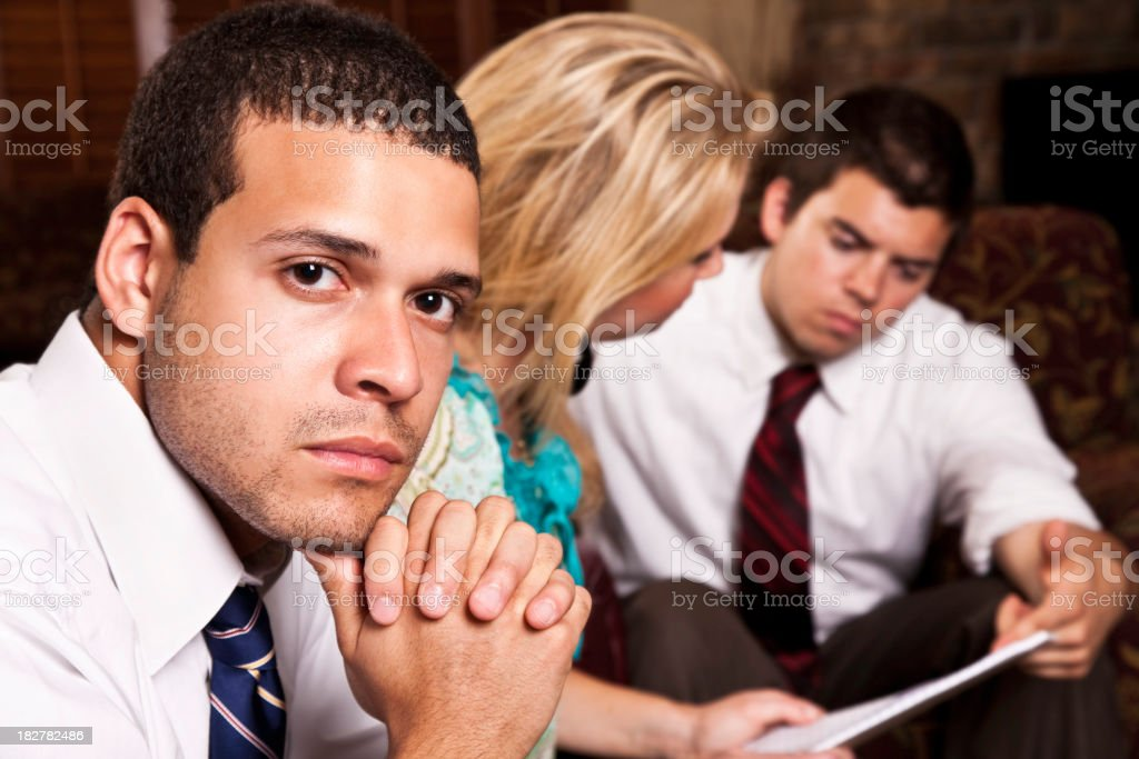Businessman Looking Up From His Business Meeting royalty-free stock photo