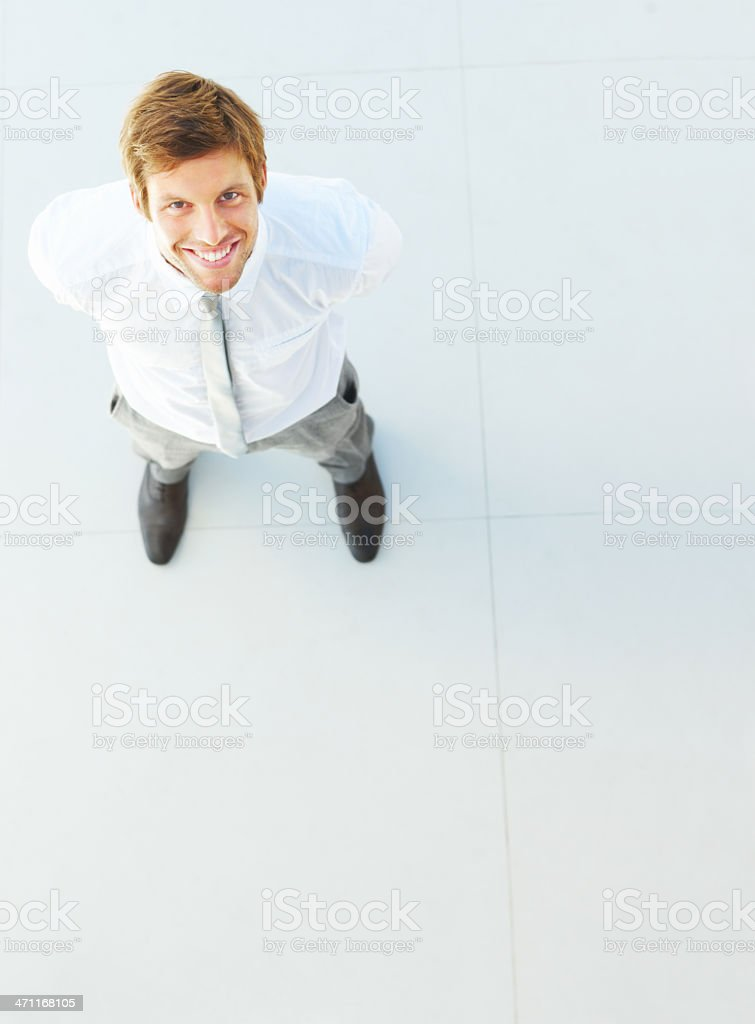 Businessman looking upward and smiling royalty-free stock photo
