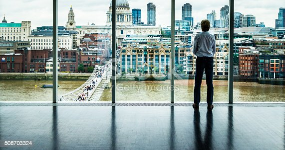 istock Businessman looks at the London Skyline from his Office Window 508703324