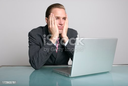 istock Businessman Looks Bored in front of Laptop Computer at Desk 172903781