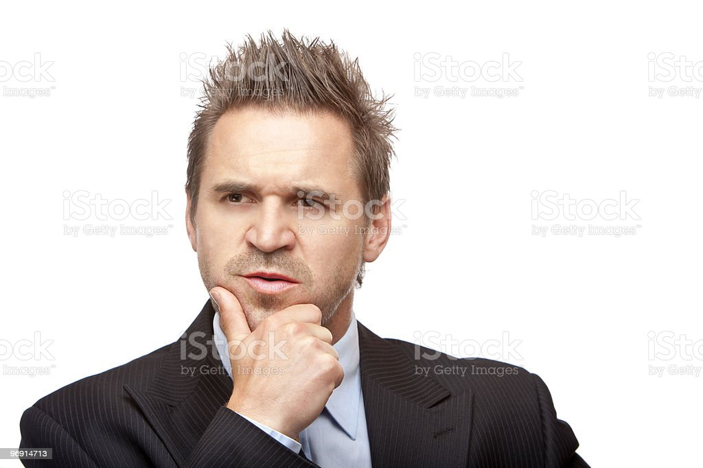 Businessman looks contemplative because of a problem royalty-free stock photo
