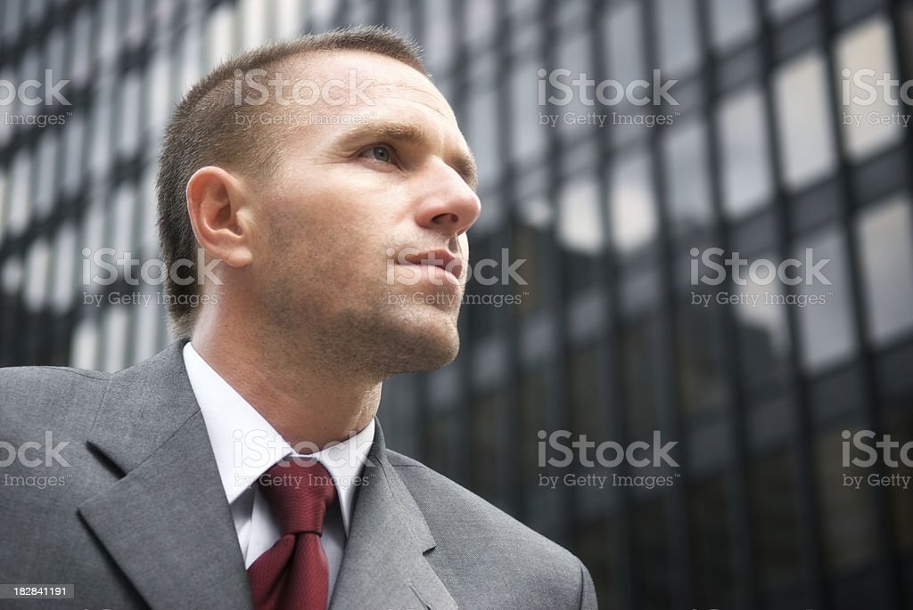 Businessman Looks Serious Skyscraper Background stock photo