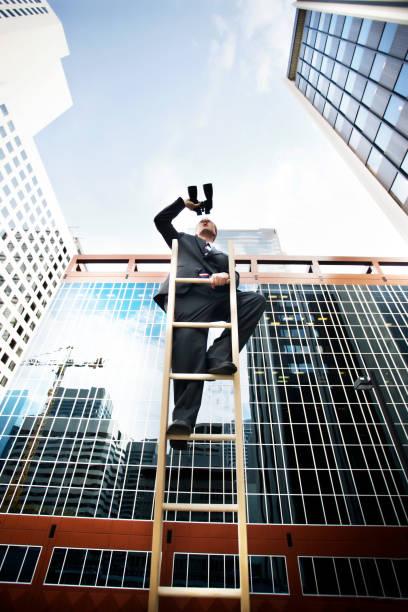 businessman looks to the future stock photo