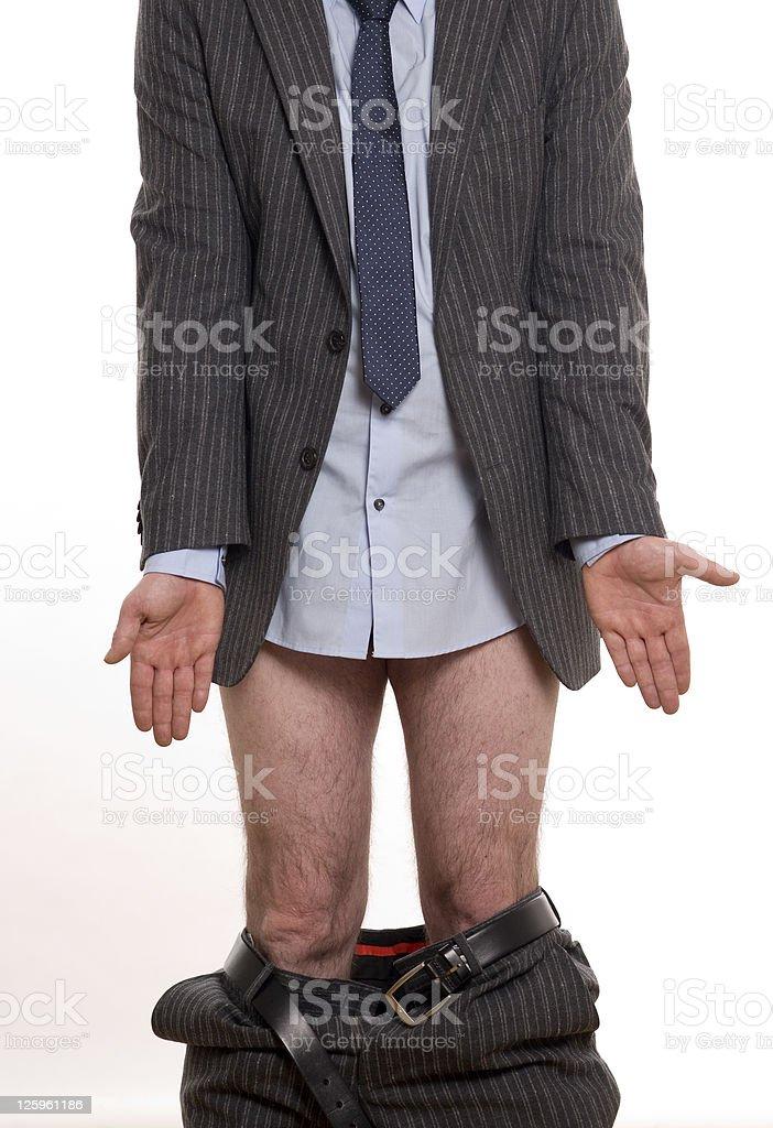 Businessman losing pants stock photo