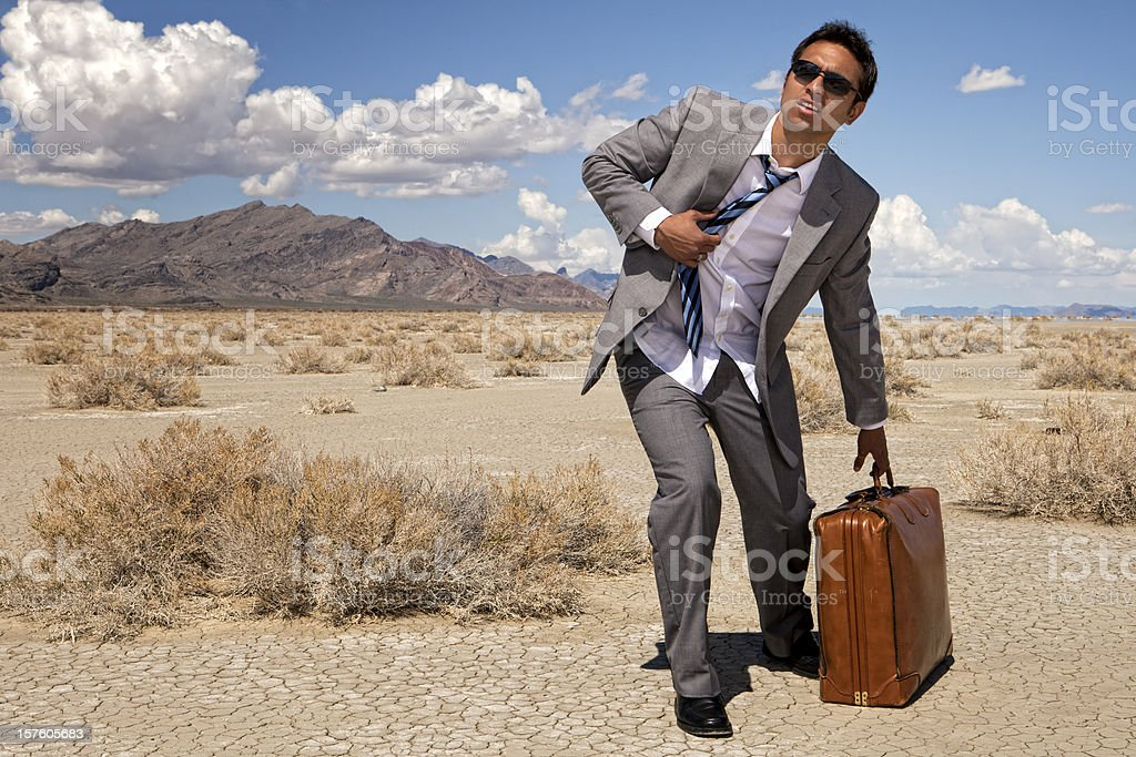 Businessman Lost In The Desert stock photo