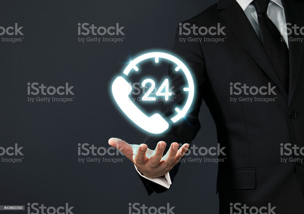 Businessman magical touch concept -  24 hours stock photo