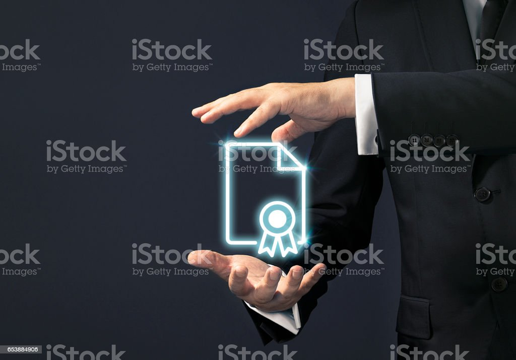 Businessman magical touch concept -  univercity diploma - foto stock