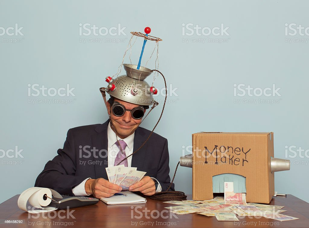 Businessman Makes Money Out of his Mind stock photo