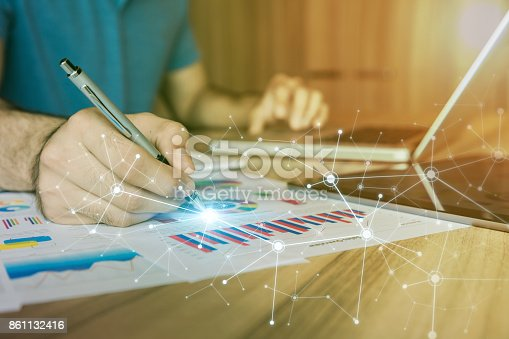 istock businessman making a note. Internet of Things. Information Communication Technology. mixed media. 861132416