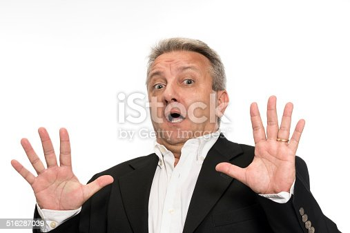 805011368 istock photo Businessman making a stop gesture 516287039