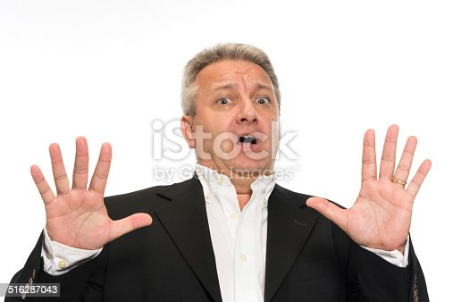 805011368 istock photo Businessman making a stop gesture 516287043