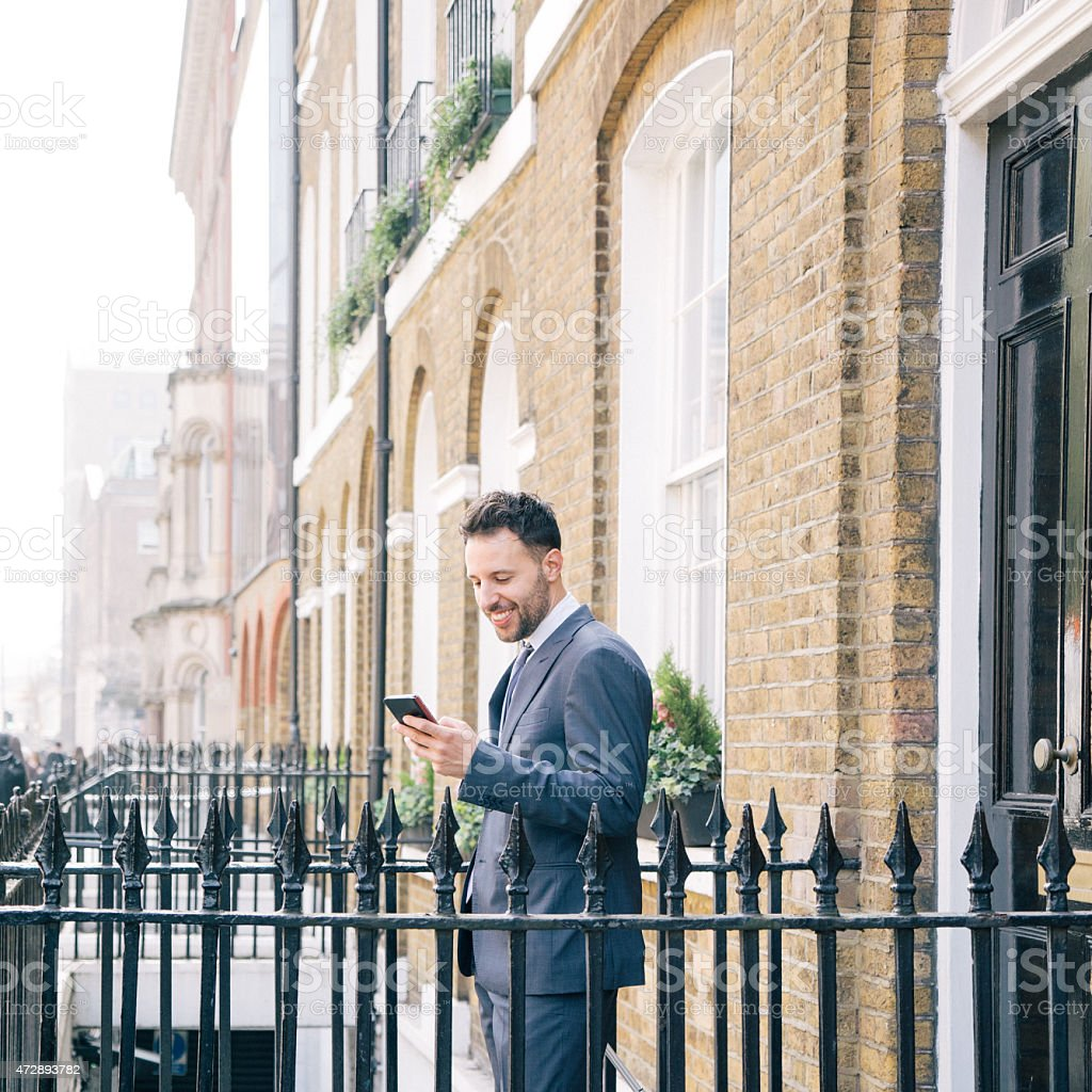 Businessman Making A Video Call While Leaving Home, Morning Time stock photo