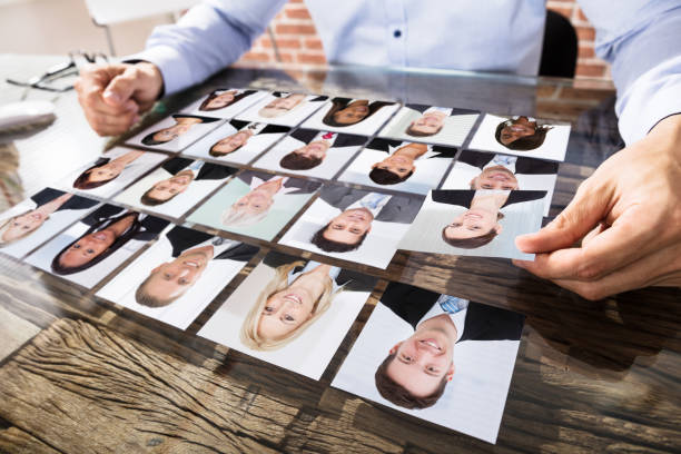 businessman making candidate selection for job - job search stock photos and pictures