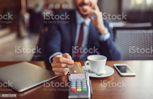 Businessman making contactless payment with credit card picture id625272376?b=1&k=6&m=625272376&s=612x612&h=cs3h7zo05yp gw3jm2oin4gtkv5hhhw 2ty6xrvp js=