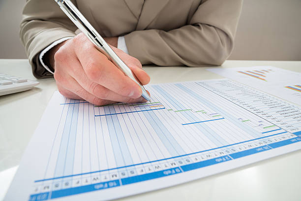 Businessman Making Gantt Diagram Close-up Of Businessman With Pen Making Gantt Diagram gantt chart stock pictures, royalty-free photos & images