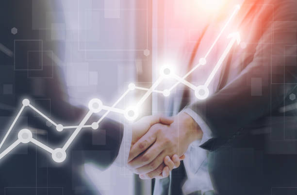 Businessman making handshake with a businesswoman on futuristic technology connection shape motion blur background with graph and chart rise up.Greeting and dealing business success concepts. stock photo