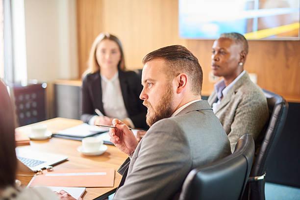 businessman making his point - four lawyers stockfoto's en -beelden