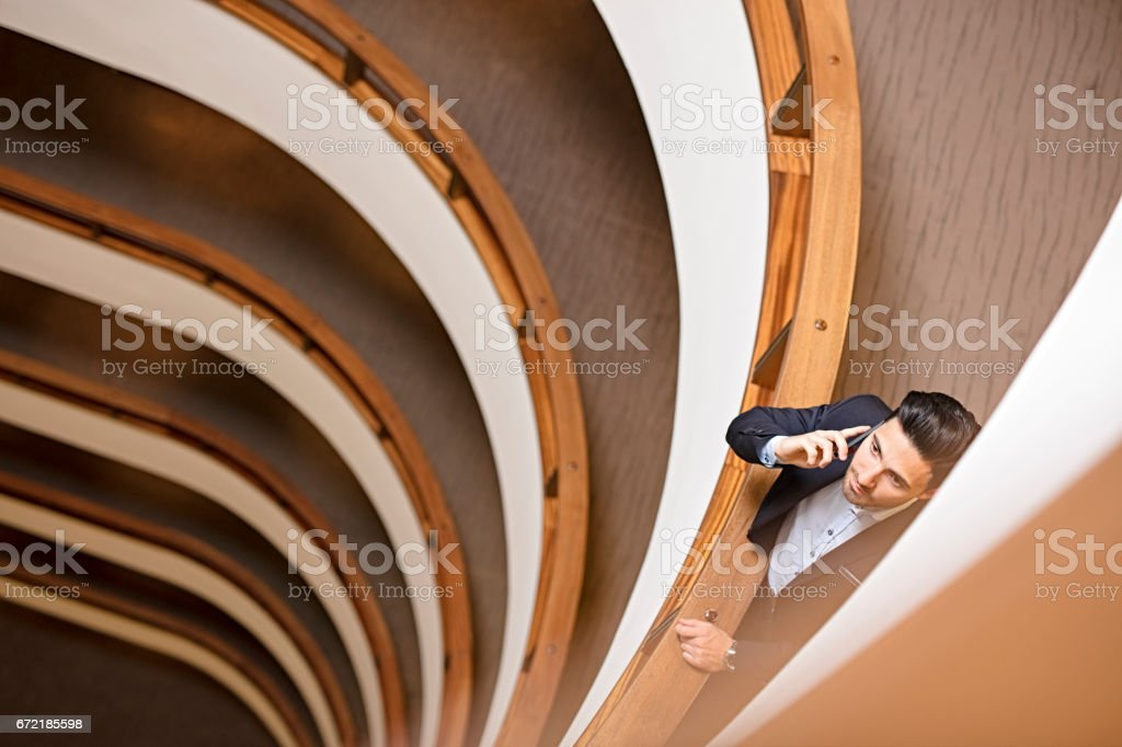 Businessman making phone call in an office building stock photo
