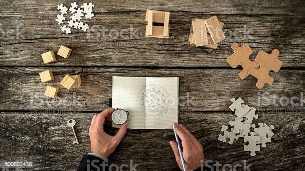 Businessman Making Plan And Business Strategy Decisions As He Sk Stock Photo - Download Image Now