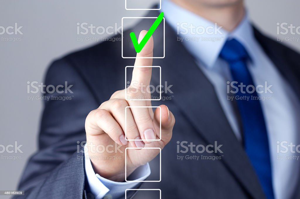 Businessman making right decision touching screen interface stock photo
