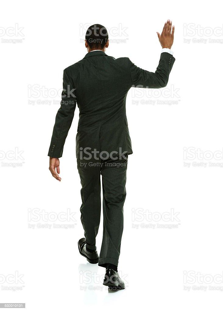 Businessman man walking away stock photo