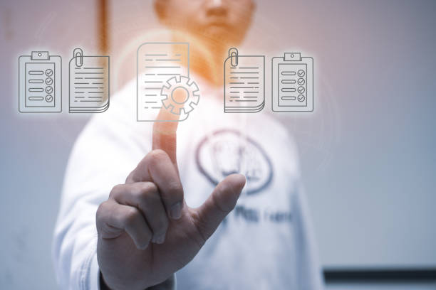 Businessman Manager hands touching documents reports paperworks of files iot icon  for paperless concept : Sign press on digital screen data system on document report HR techonlogy form office. stock photo