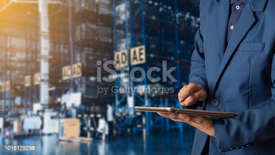 istock Businessman manager using tablet check and control for workers with Modern Trade warehouse logistics. Industry 4.0 concept 1015125238