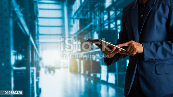 istock Businessman manager using tablet check and control for workers with Modern Trade warehouse logistics. Industry 4.0 concept 1019685326