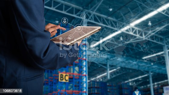 istock Businessman manager using tablet check and control for workers with Modern Trade warehouse global business commerce concept or import-export commercial logistic. Industry 4.0 concept 1068073618